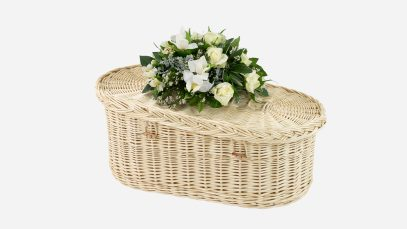Baby crib casket featuring plaited loop and wooden toggle closures, in the natural white willow colour