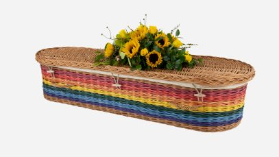 Child's willow coffin with a curved-end shape in rainbow colours, featuring buff woven willow handles