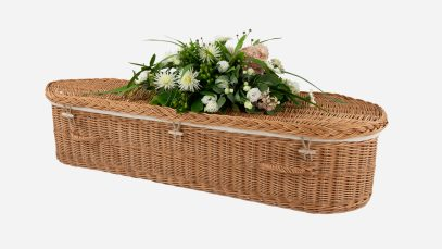 Child's willow coffin with a curved-end shape, buff in colour and featuring buff woven willow handles