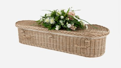 Child's willow coffin with a curved-end shape, weatherbeaten gold in colour and featuring weatherbeaten gold woven willow handles