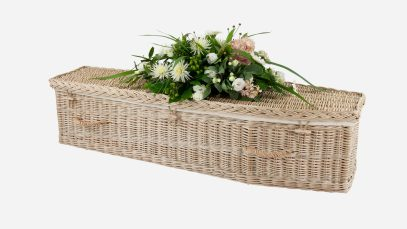 Child's willow coffin with a traditional shape, weatherbeaten gold in colour and featuring weatherbeaten gold woven willow handles